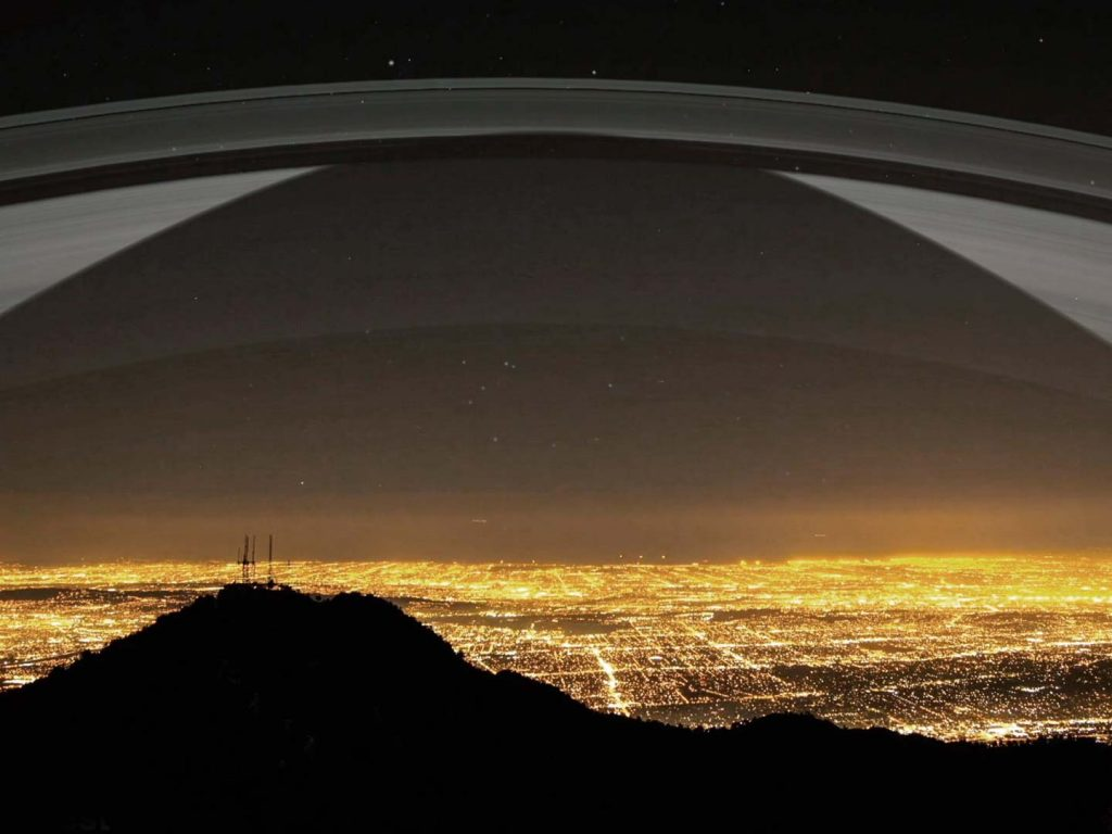 Los Angeles at 34 Degrees north sees the rings high in the sky. In this image the shadow of earth reflects on the rings at night.