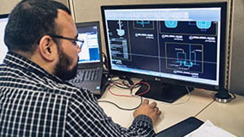 Gentleman looking at computer drawings