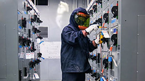 guy in electric room in full safety gear