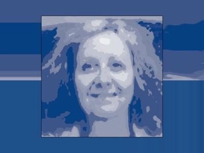 Indigo monochrome image of artist