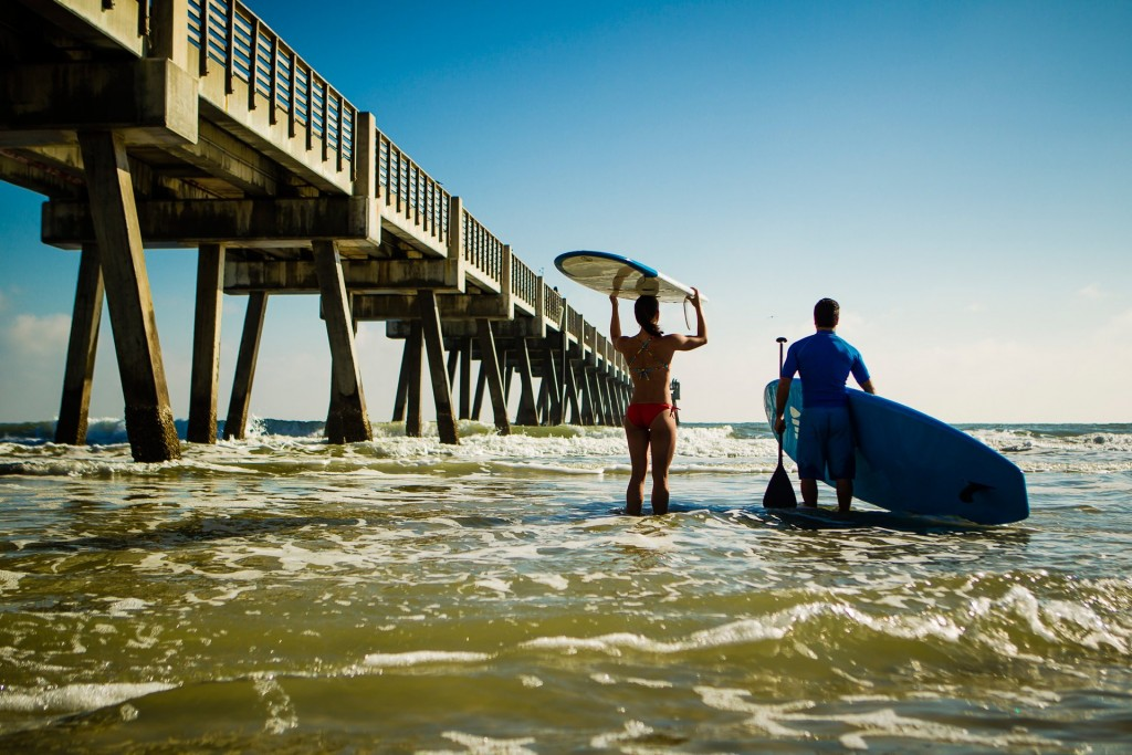 Couple ready to surf and paddleboard in Jacksonville Beach credit Ryan Ketterman