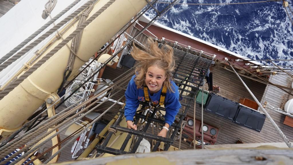A World Academy Student climbing aloft