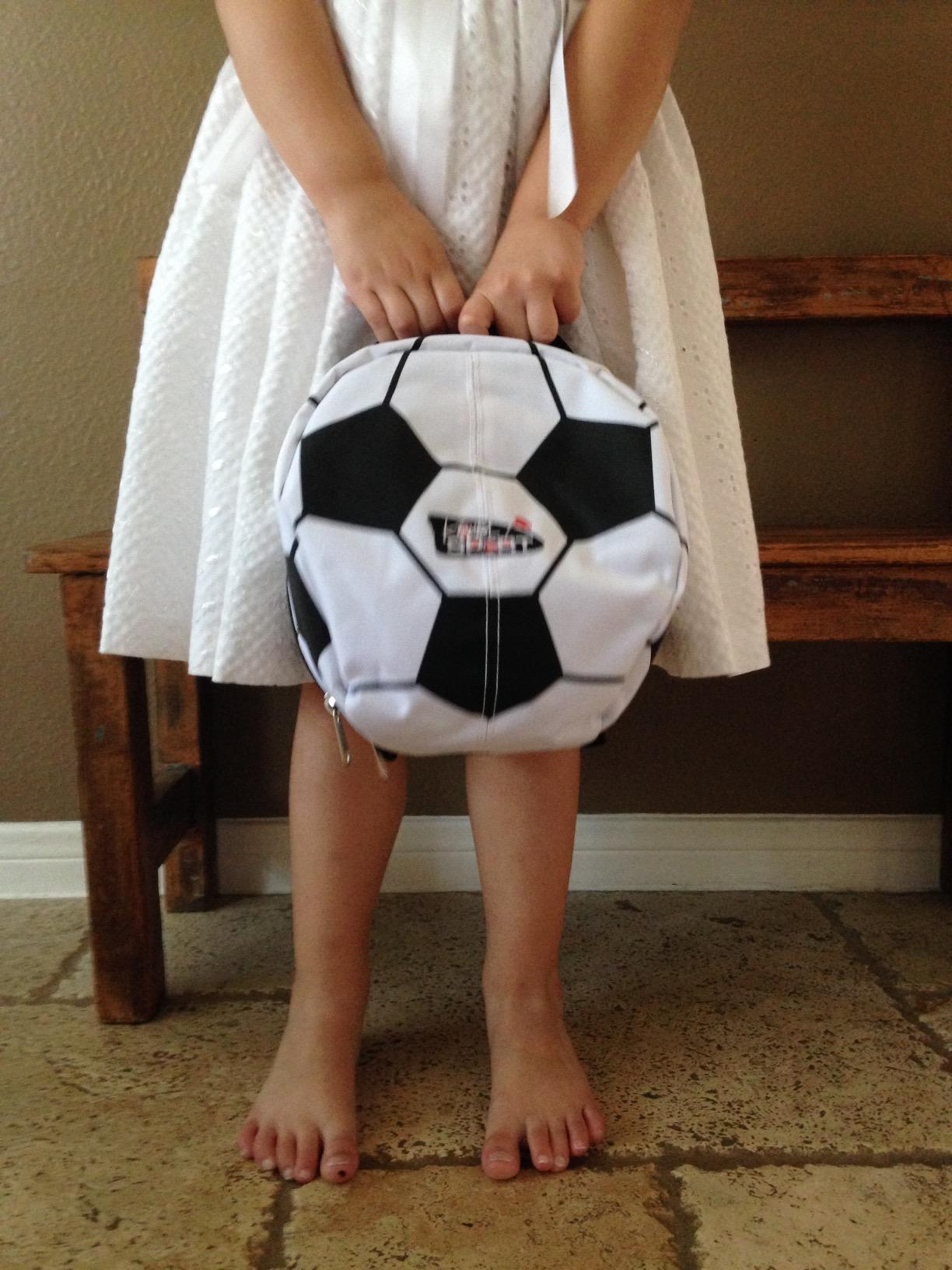 A Little girl enjoying here sport pack