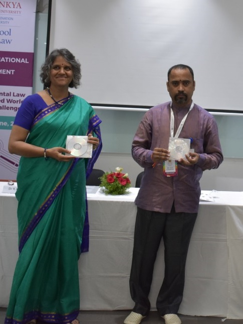 Dr Ujjwala Barve HeadDepartment of Communication  Journalism Savitribhai Phule Pune University and Dr K K S R MurthyHeadADYPU School of Law unveiling the research papers  Second International Faculty Development Program at ADYPU