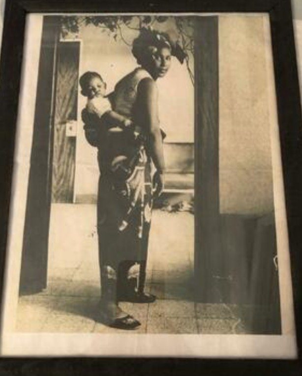 Mr Chapoteau as a baby carried by his mother during his time in Congo