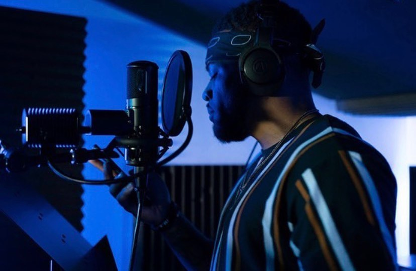 Malcolm Whye Mindset of a Hustler CEO in recording studio