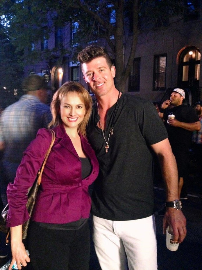 Patricia Pinto with Robin Thicke on set