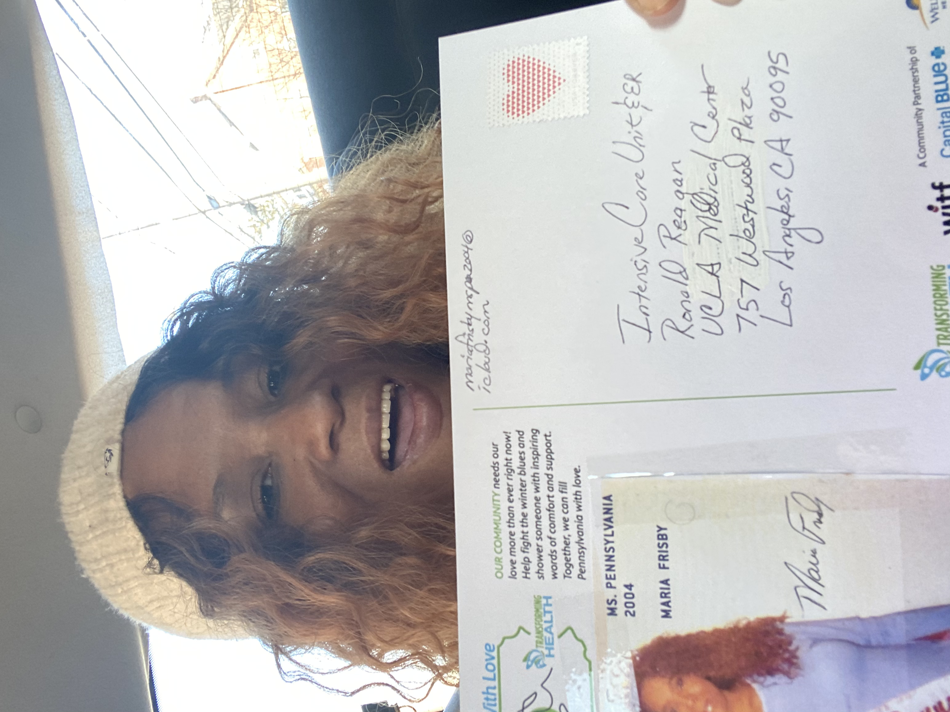 Maria showing another postcard which was sent to a hospital in Los Angeles CA