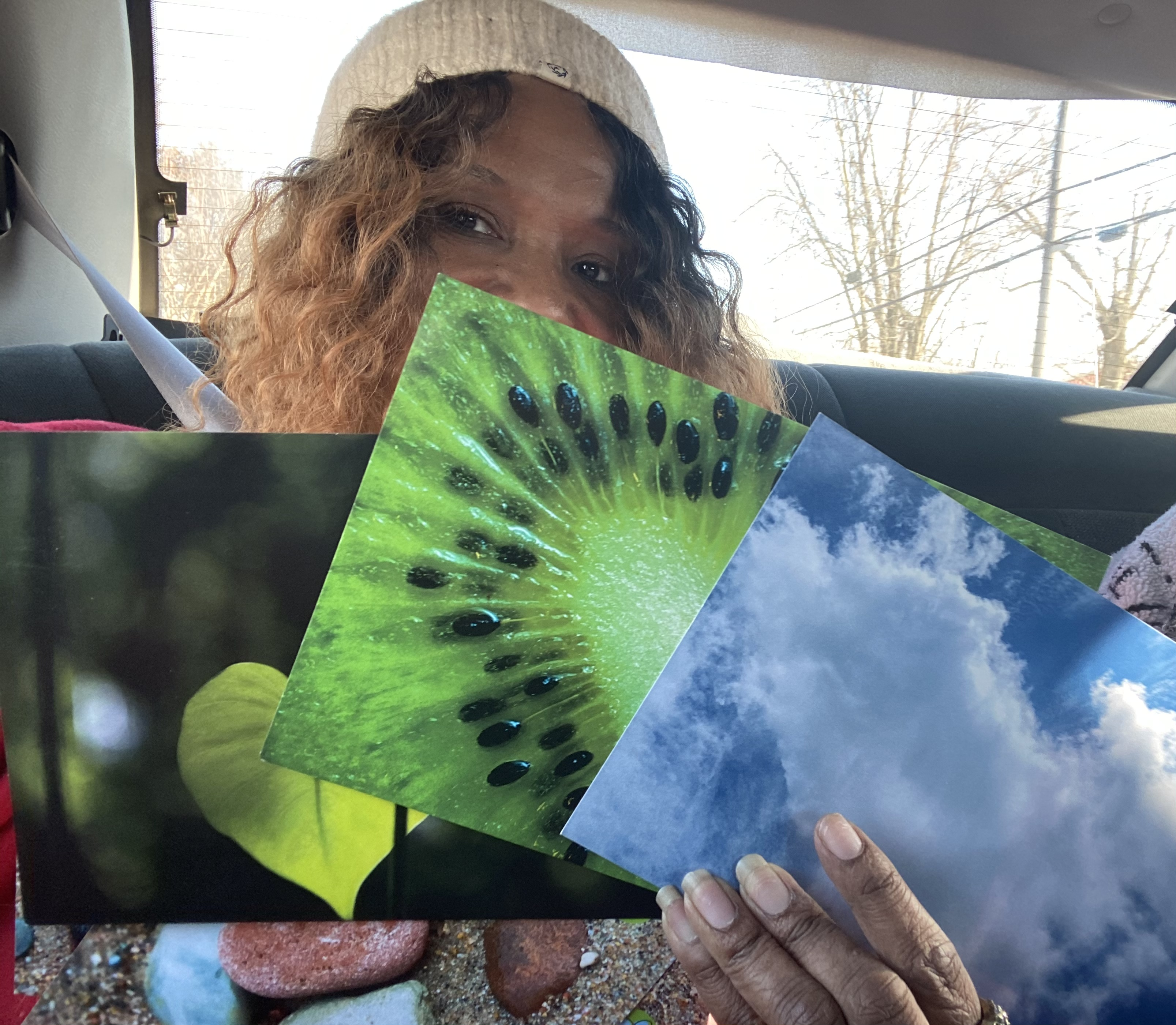 Maria showing some of the postcards that she sent to ERICU staff at hospitals in the USA