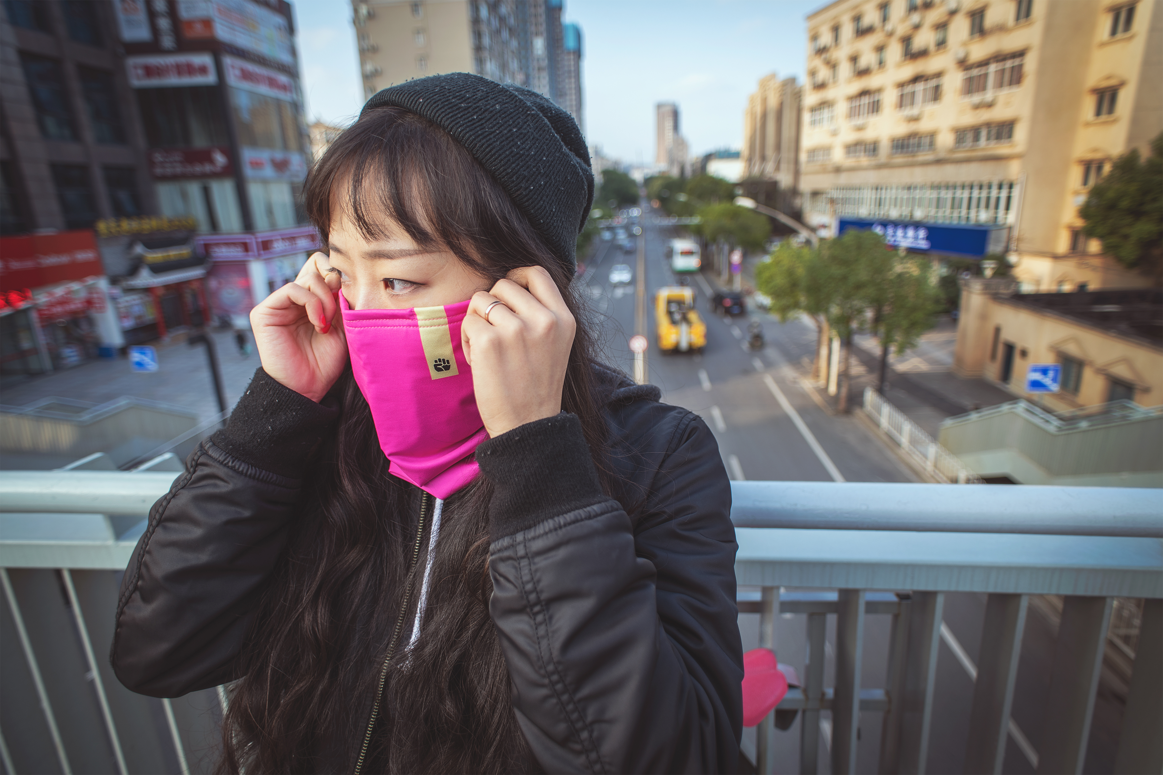 Woman wearing scarf in the city