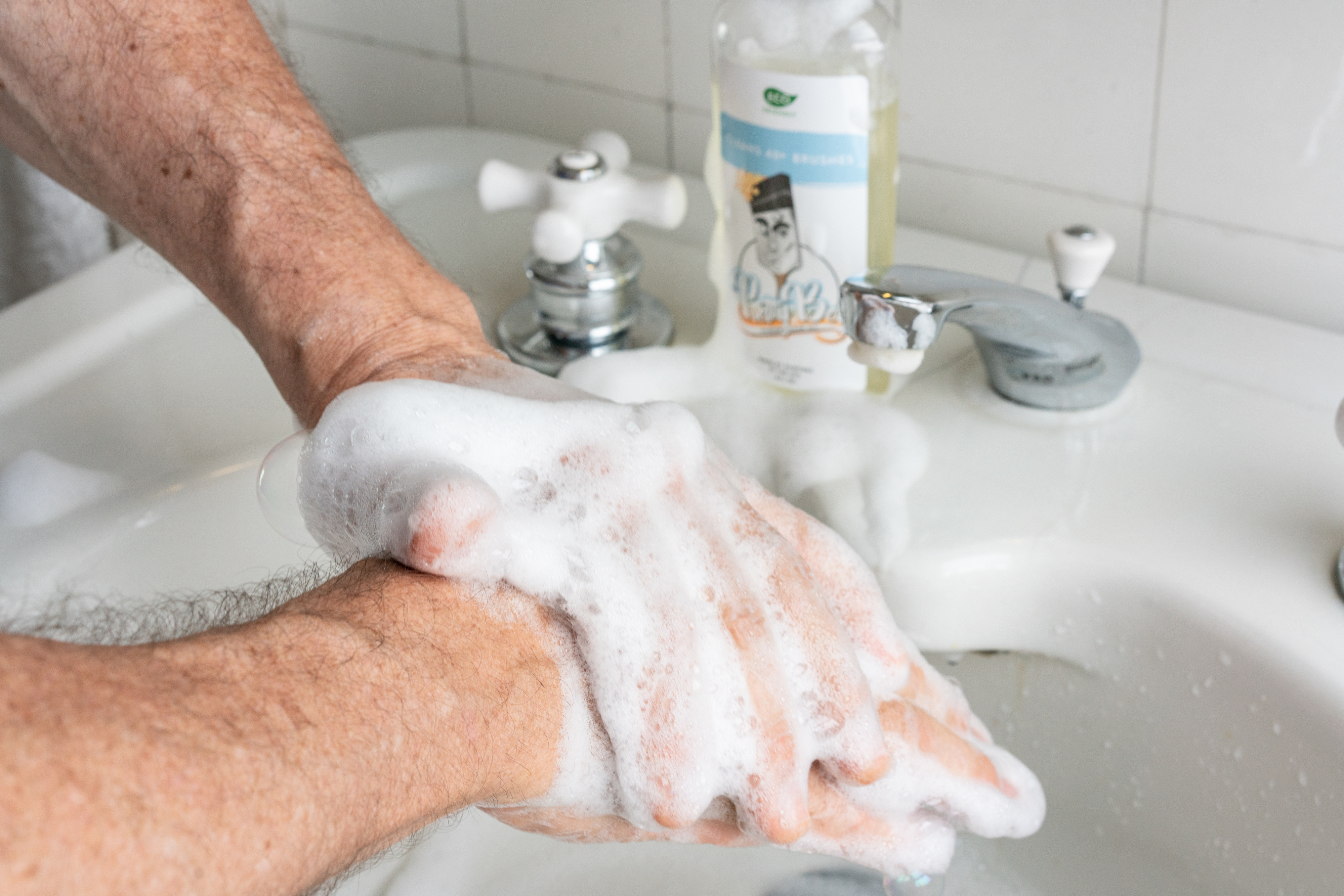 Pretty Boy cleaning hands after painting Gentle on skin