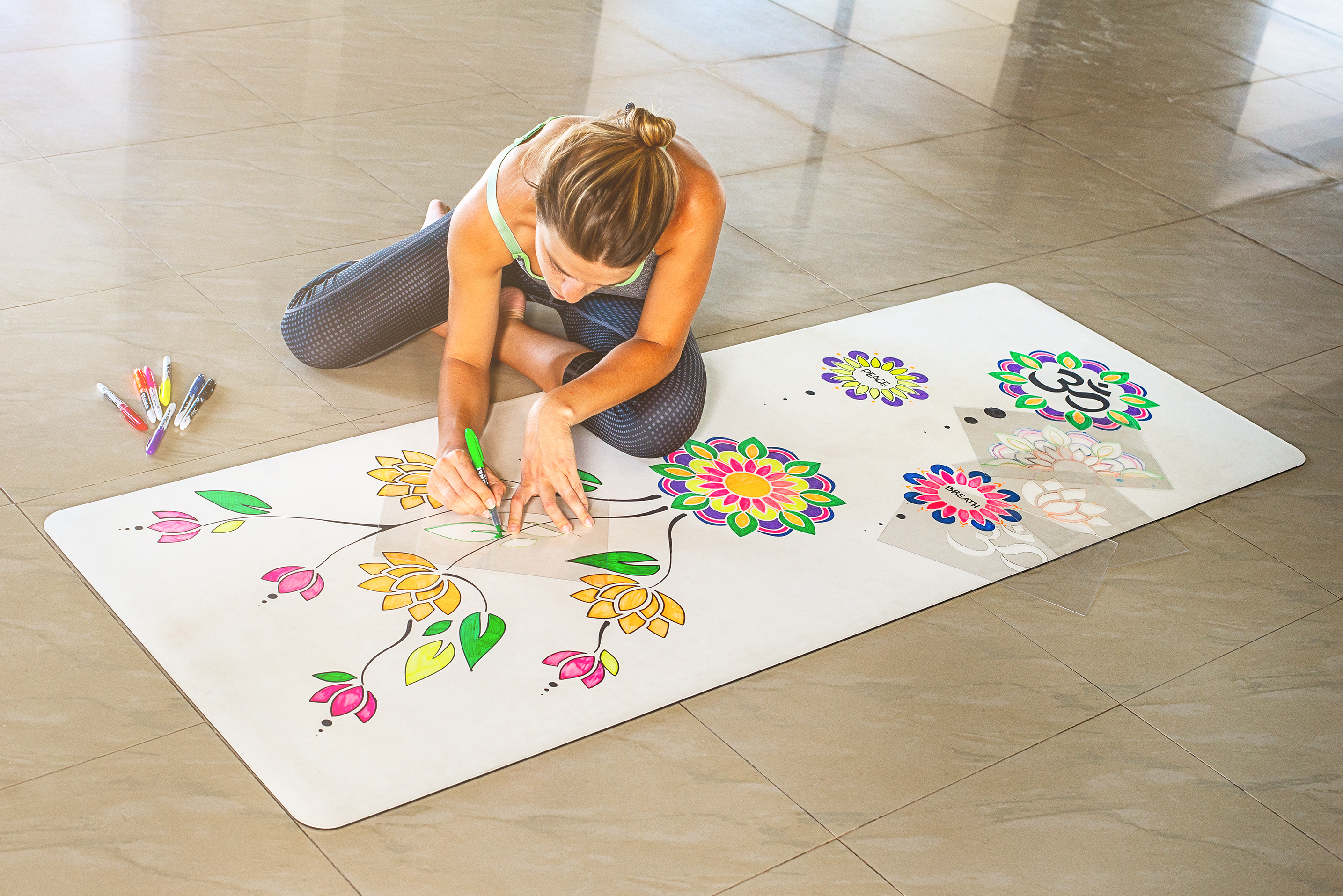 Drawing on the DIYogi yoga mat using markers and stencils