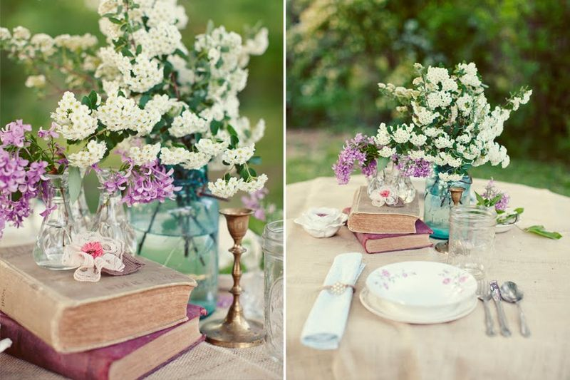 Wedding-table-setting-ideas-vintage-books-blue-mason-jar-centerpieces-white-flowers
