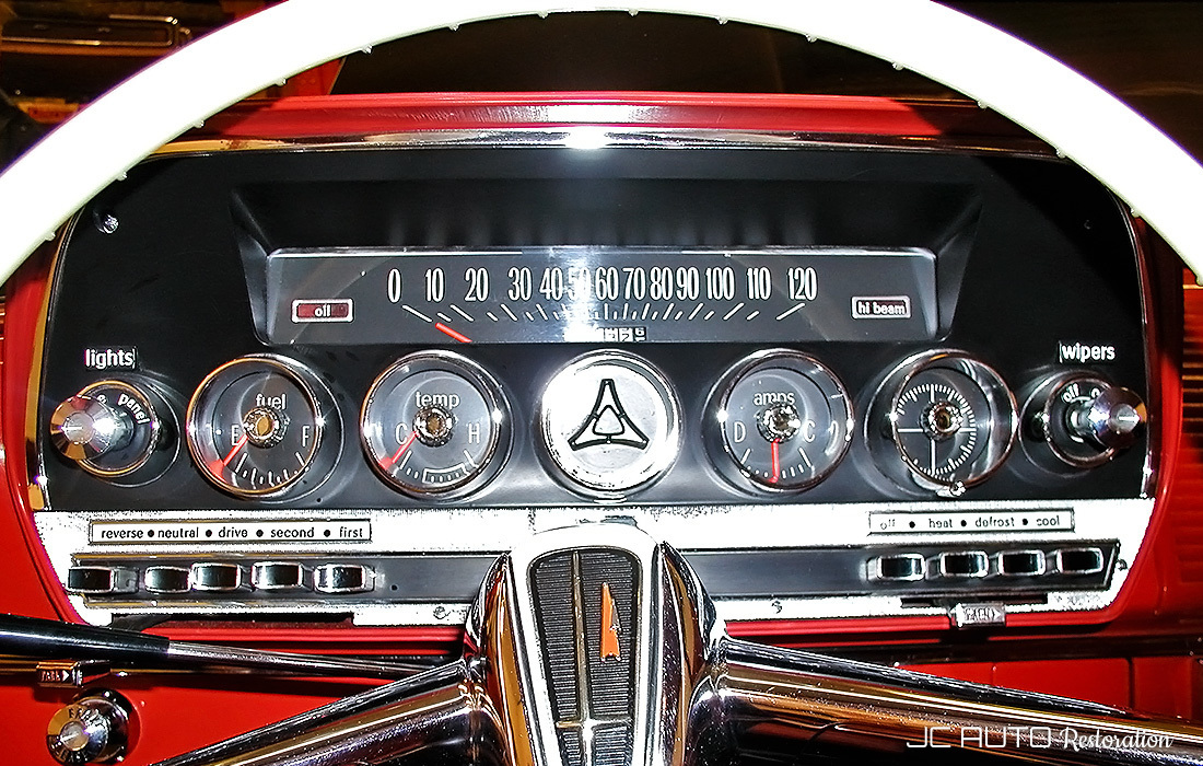 The instrument cluster and steering wheel are restored and everything is fully functional.