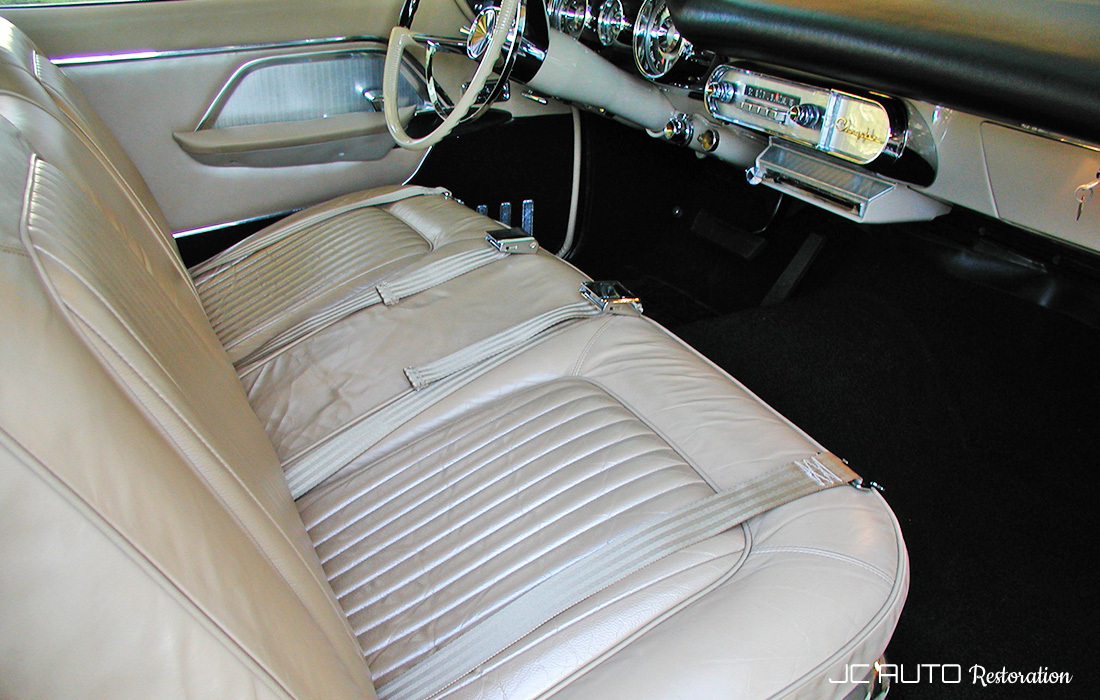 We restored the complete interior, including installing a new headliner, seats, door panels, trunk kit, and carpets by Gary Goers and reproduction door sills.