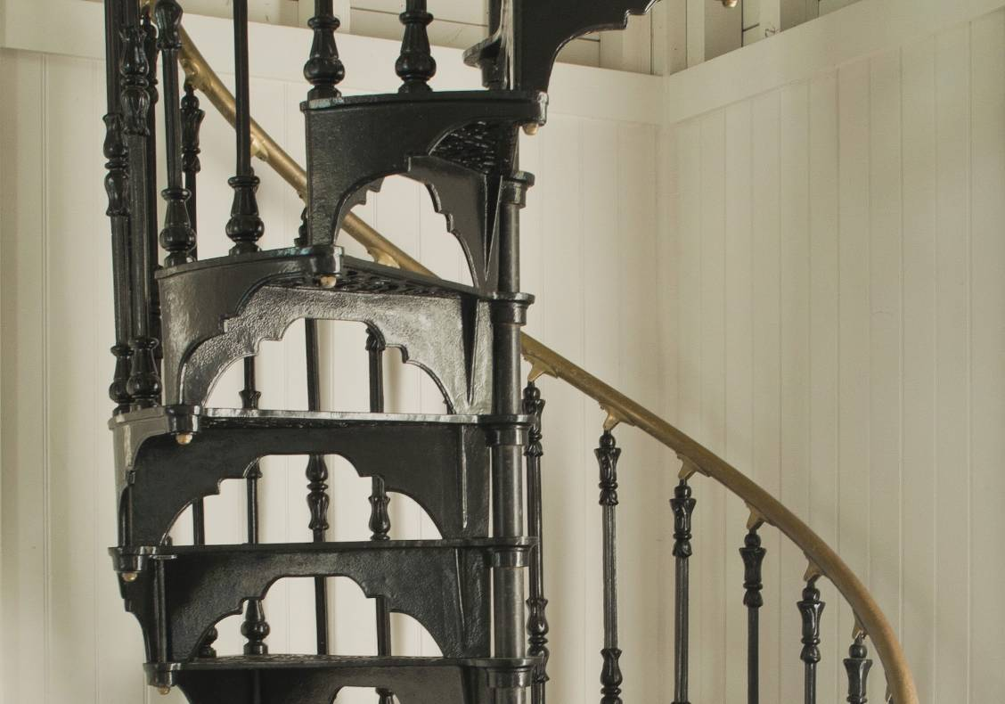 A victorian cast iron staircase leads to an overlook room in the tower.