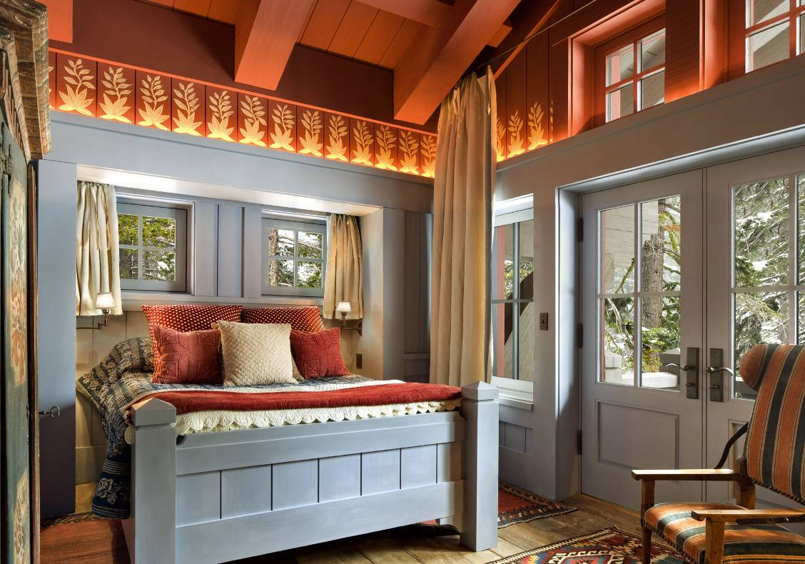 Guest bedroom with custom made bed, heavy timber ceiling, balcony to front porch.