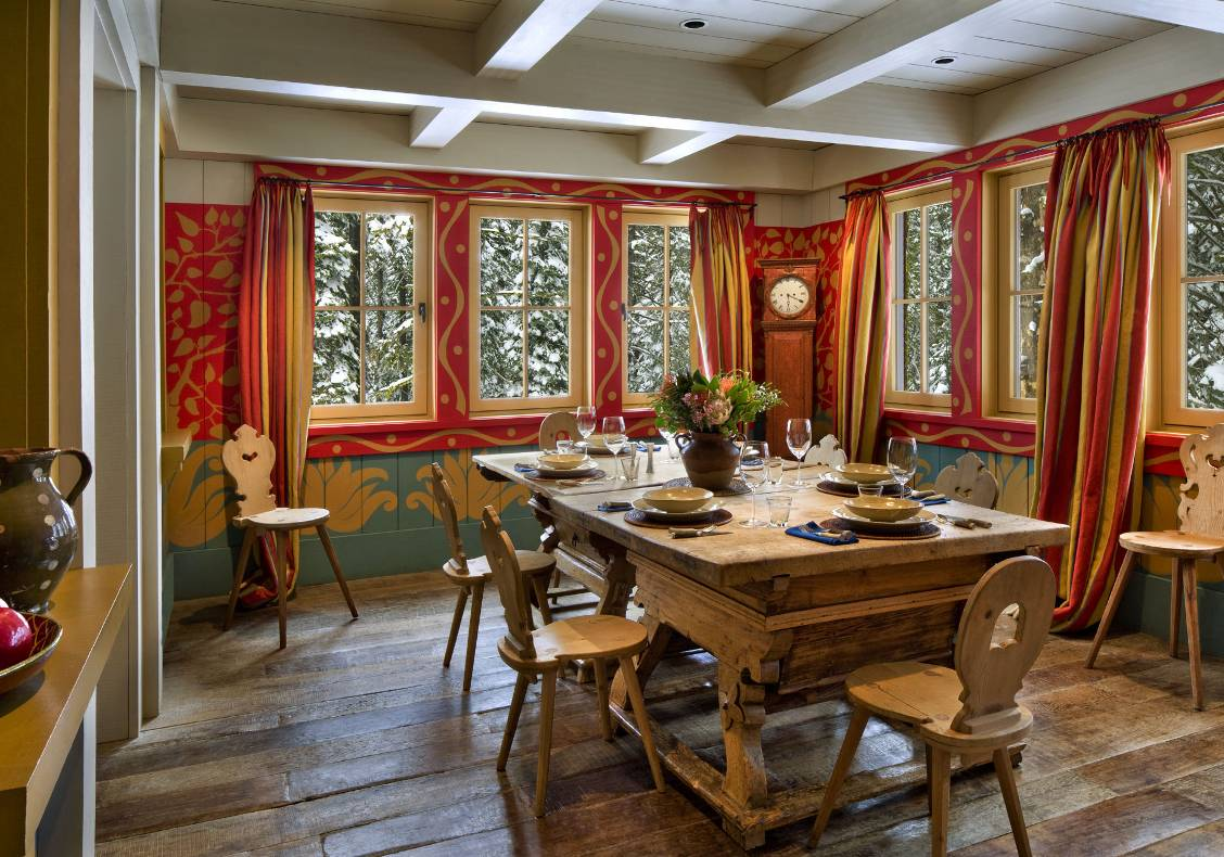 Dining room with antique alpine table and chairs, reclaimed oak flooring.