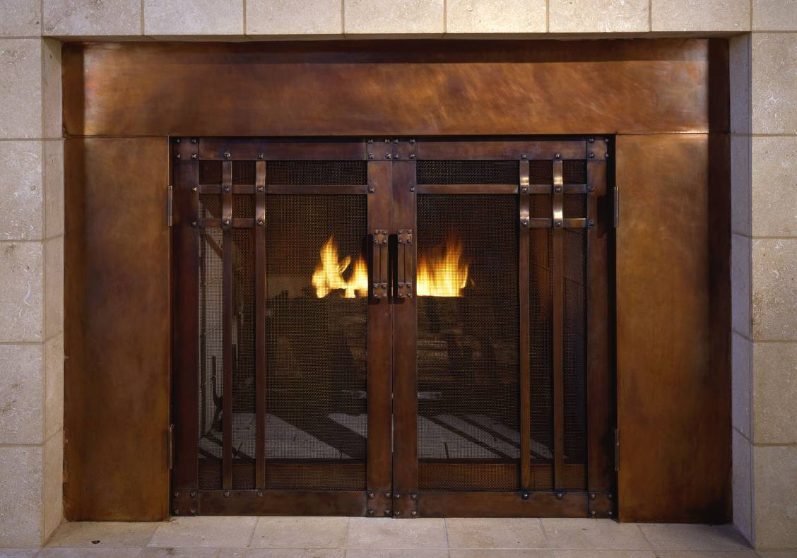 The hand forged fire guard was designed to complement the interior balcony woodwork.