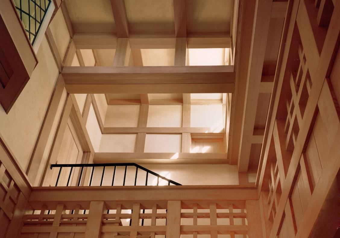 The stair hall opens to a series of dramatic clerestory windows which bring light deep into the house.