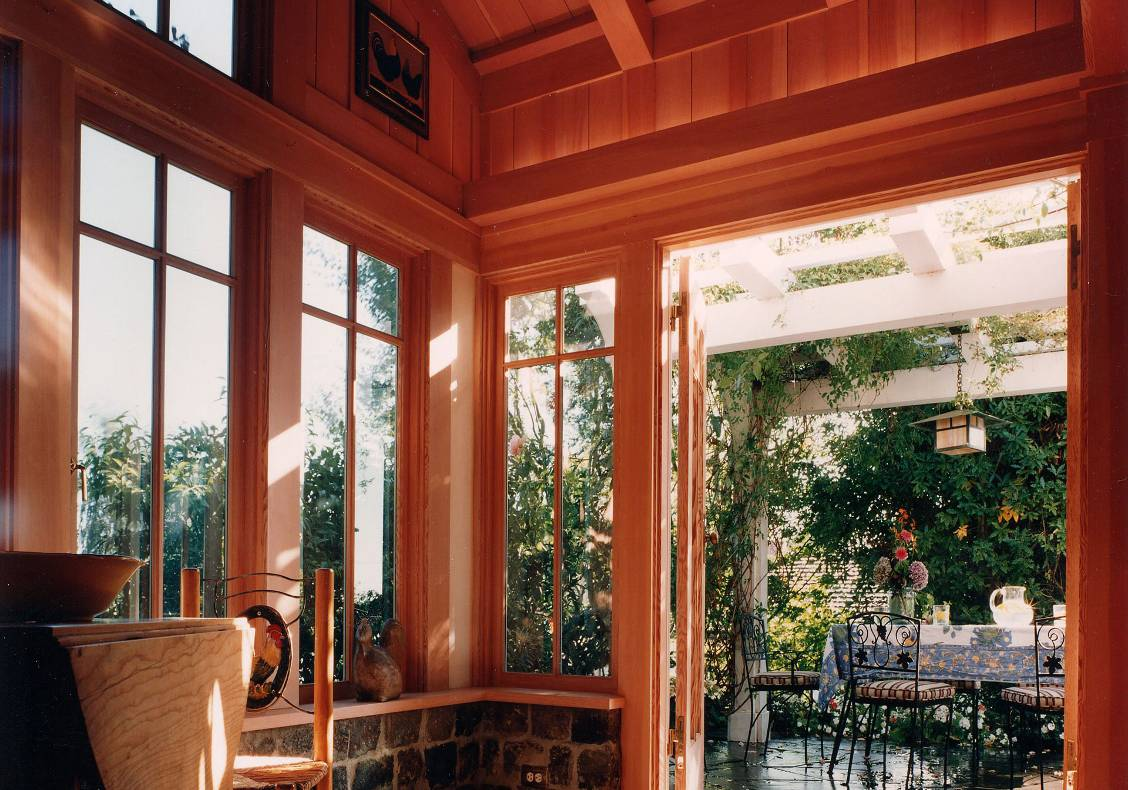The French doors lead to the garden and a shaded terrace.