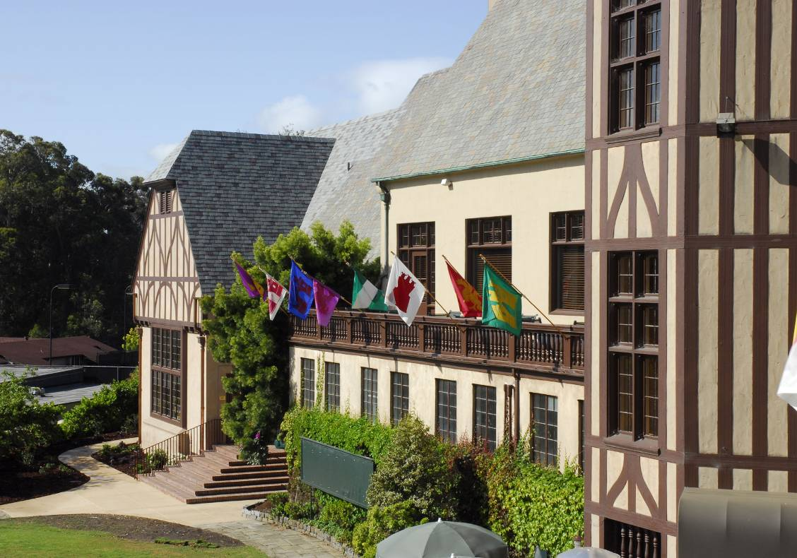 Colorful flags with old-time coats of arms decorate the rear wooden balconies of the country club, whose ivy-covered, half-timbered exterior recalls the great Tudor estates and outdoor sport traditions of England.