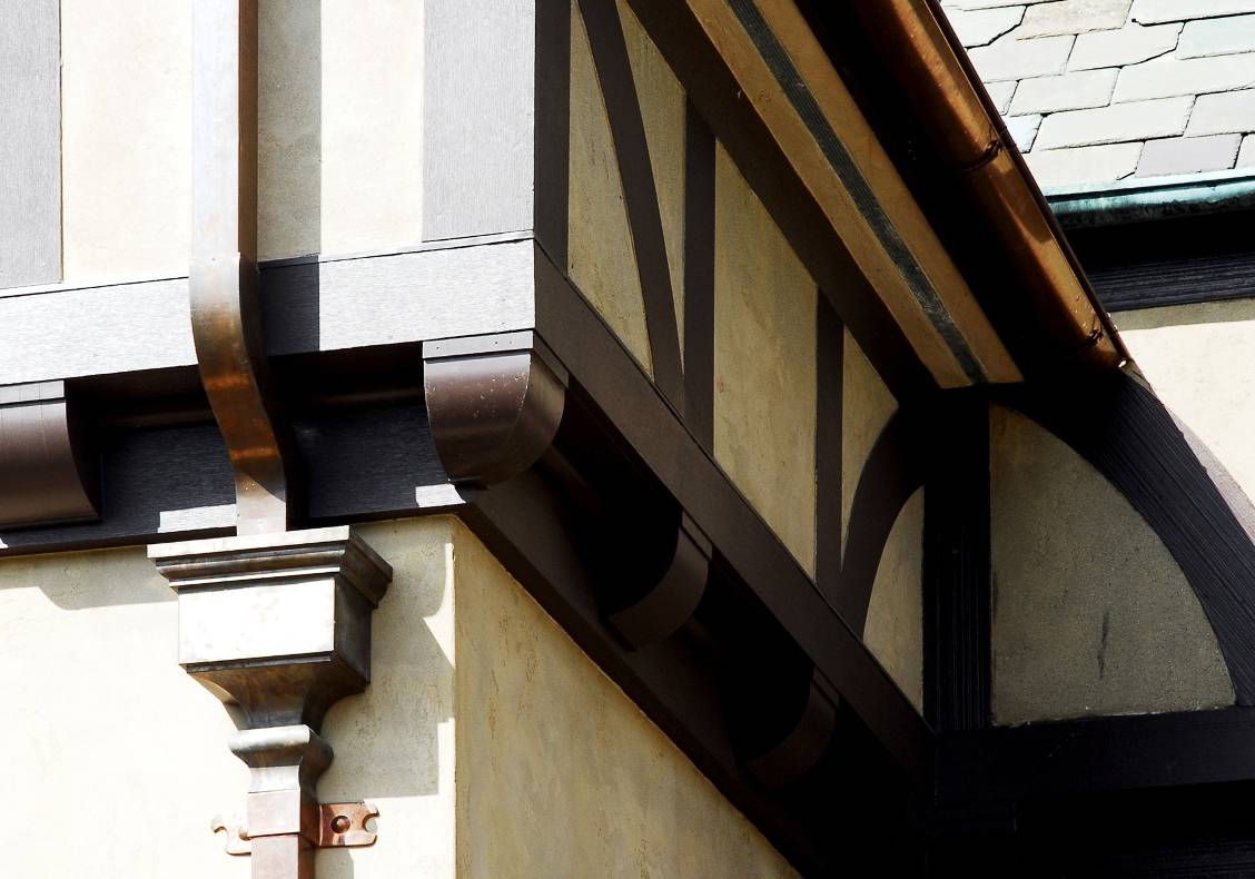 Even small details such as the metal downspouts and exterior light designs bring a great deal of character to the country club as a whole.