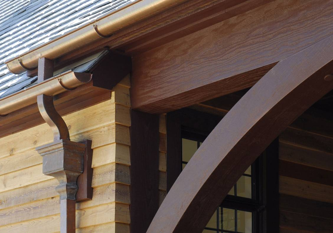 These hefty timber details give great solidity to the design of the new Aquatic Center building, and are firm in recalling an equestrian, wooden barn-like tradition.