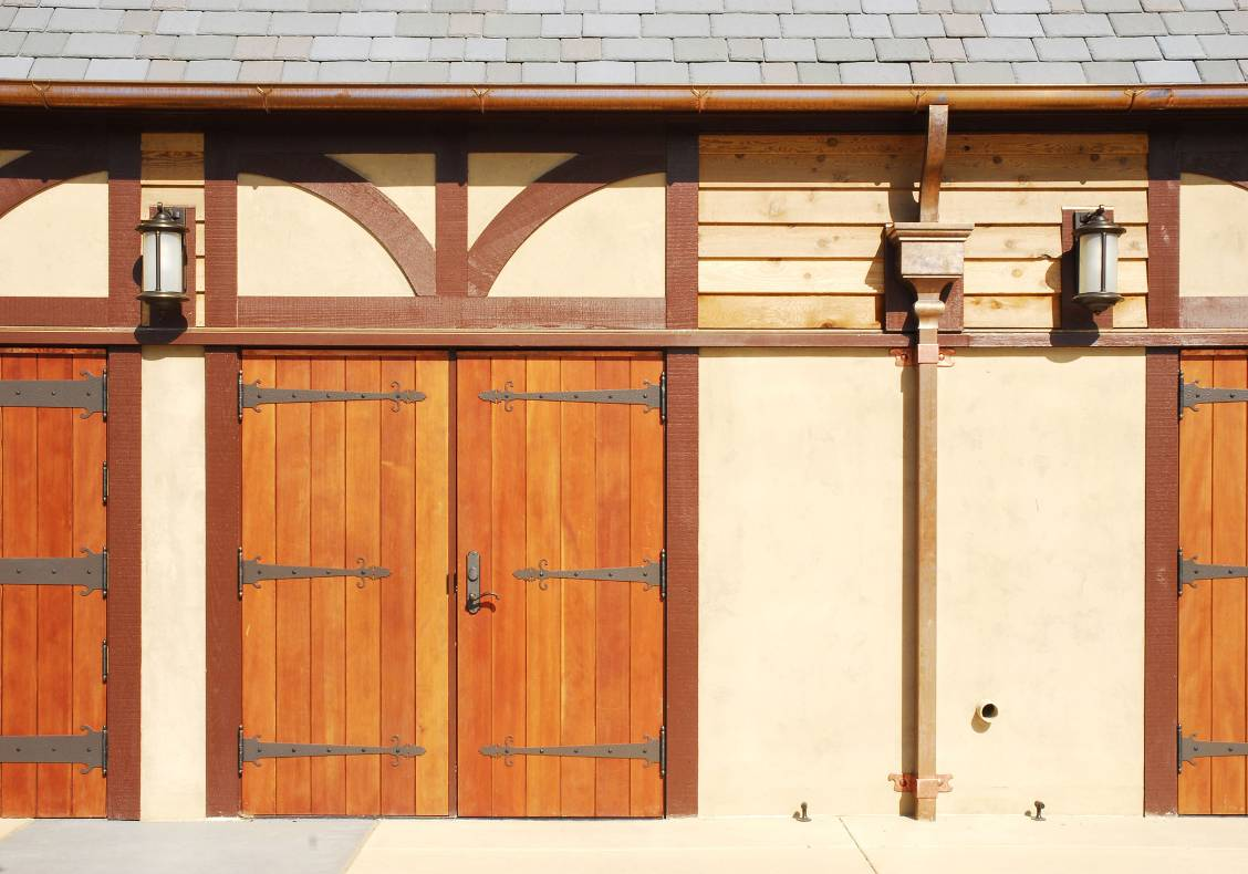The Aquatic Center's pool house design echoes an equestrian tradition in its splendid display of half-timbering and wooden barn door detailing.