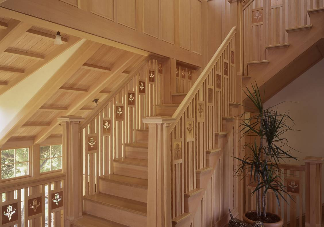 The remarkable staircase serves as the house's spine.