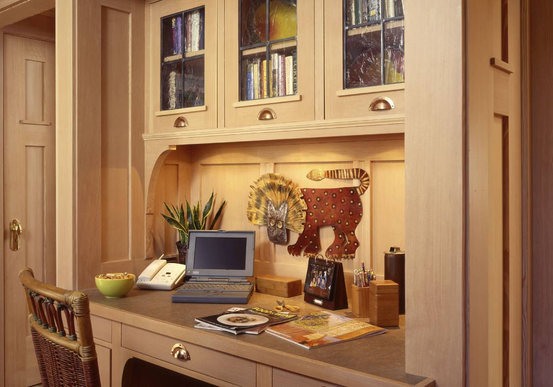 Custom built in desk with wood detailing and copper bin pulls in keeping with the Arts and Crafts aesthetic.