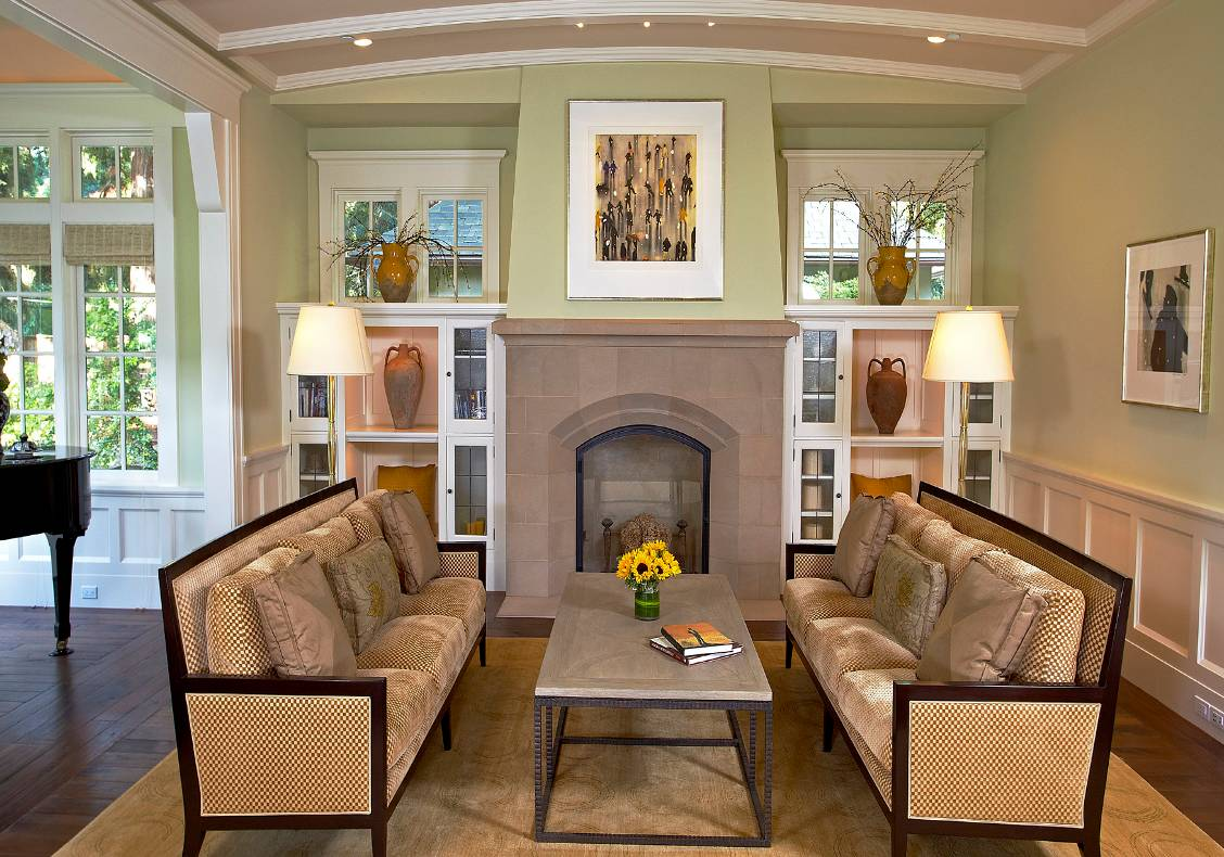 Living room with vaulted ceiling, cast stone fireplace, glazed music bay.