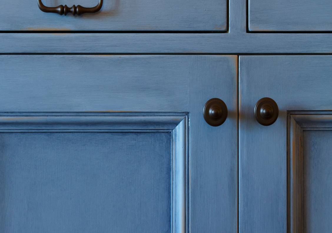 The kitchen cabinets have varied finishes.