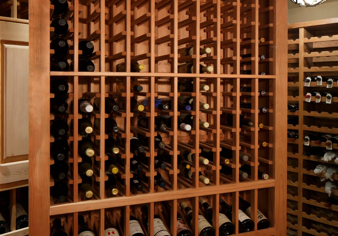 For special guests, the owner pivots out one of the wine cellar's redwood wine racks to reveal a secret chamber for the safekeeping of special vintages.