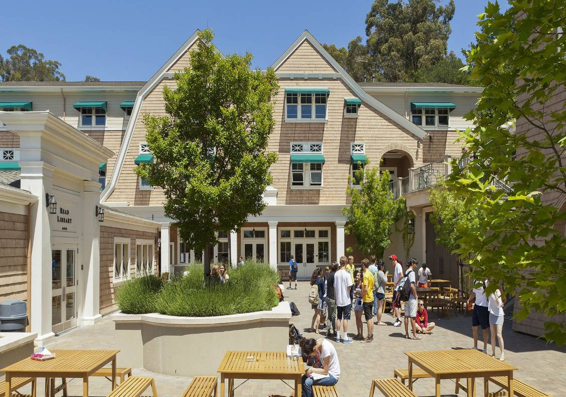 """A central courtyard or """"close"""" is the place where students and faculty meet and interact between classes.  This sunny courtyard replaced narrow, dim interior corridors as the student gathering spaces."""