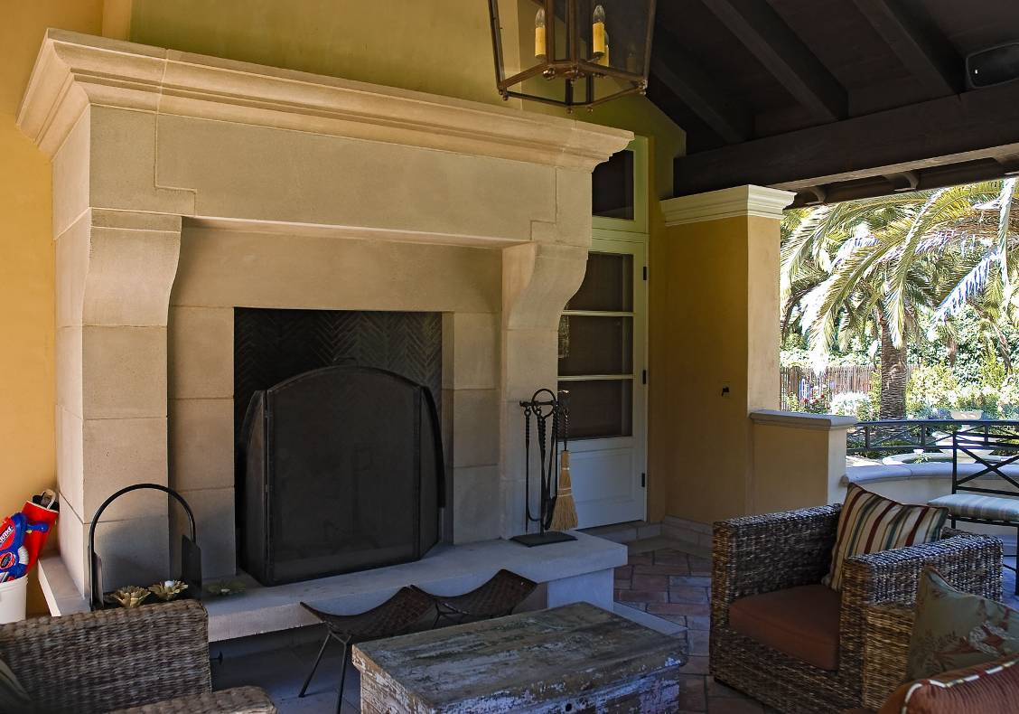 The covered porch features an outdoor fireplace.