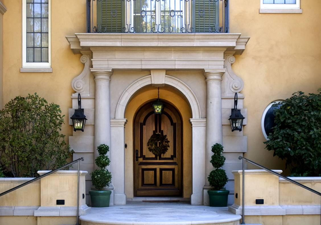 The front door is set within a specially designed stone portal.
