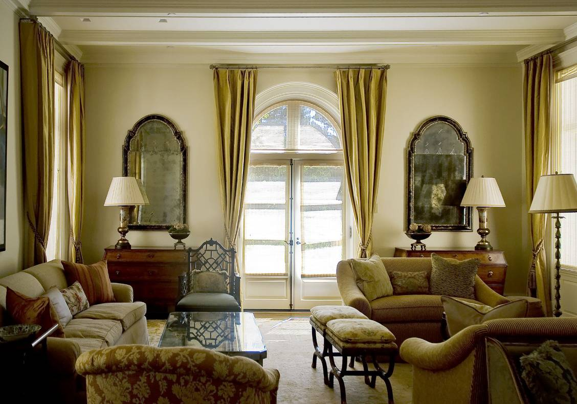 The living room maintains the symmetry and classical detailing of the house's facades.