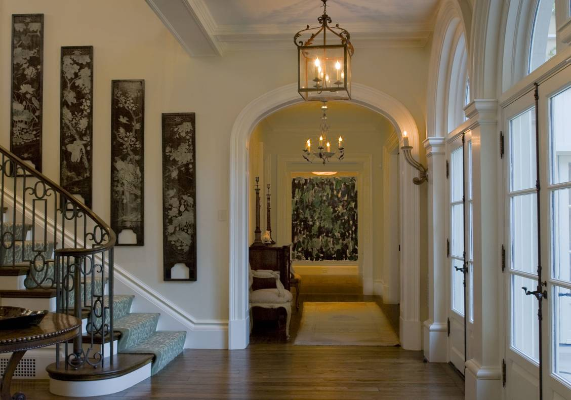 The entry hall leads to a fountain court overlooking the rear gardens.