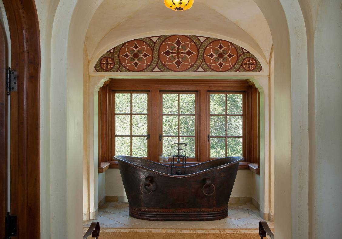 The focal point of the master bath is the pounded copper tub.