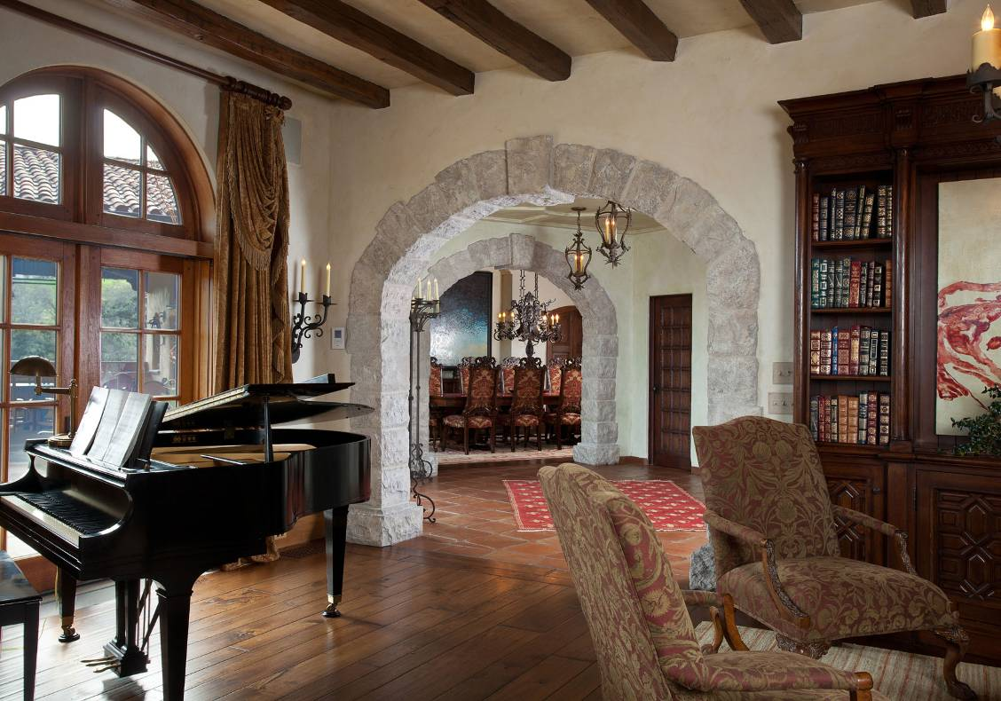 Niches, stone arches, and deep embrasures accentuate the thick walls typical of Spanish colonial construction.
