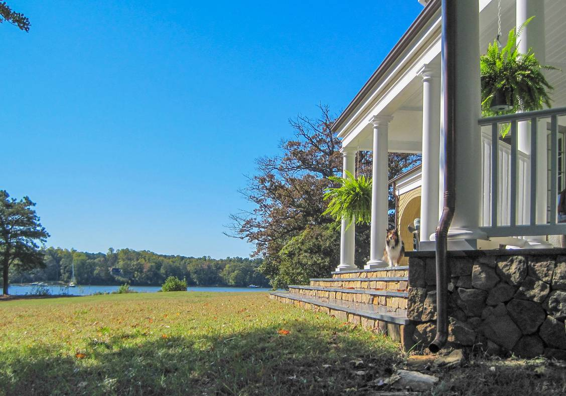 A neoclassical portico faces the path leading to the boat dock for the couple's son's sailboat.