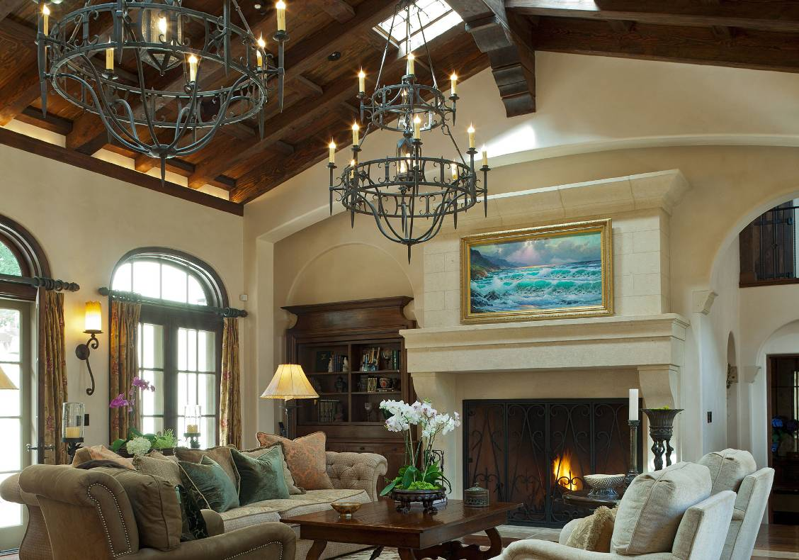 The great living room is dominated by an Italian-cut limestone mantel with a 6 foot Rumford firebox.