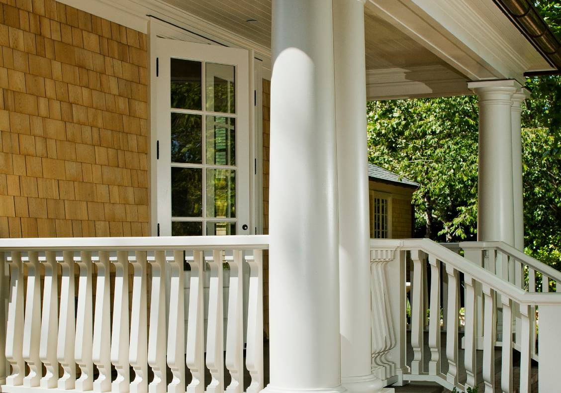 The existing pilasters were retained while new columns & railings were added.