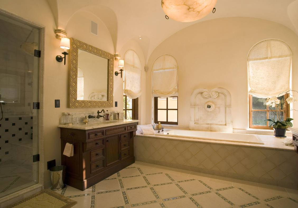 The master bath fixtures are set in warm Calacatta marble counters.