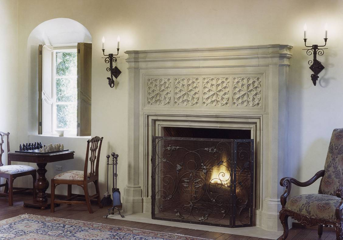 The stone fireplace and deep window alcoves are characteristic of the Spanish colonial style.