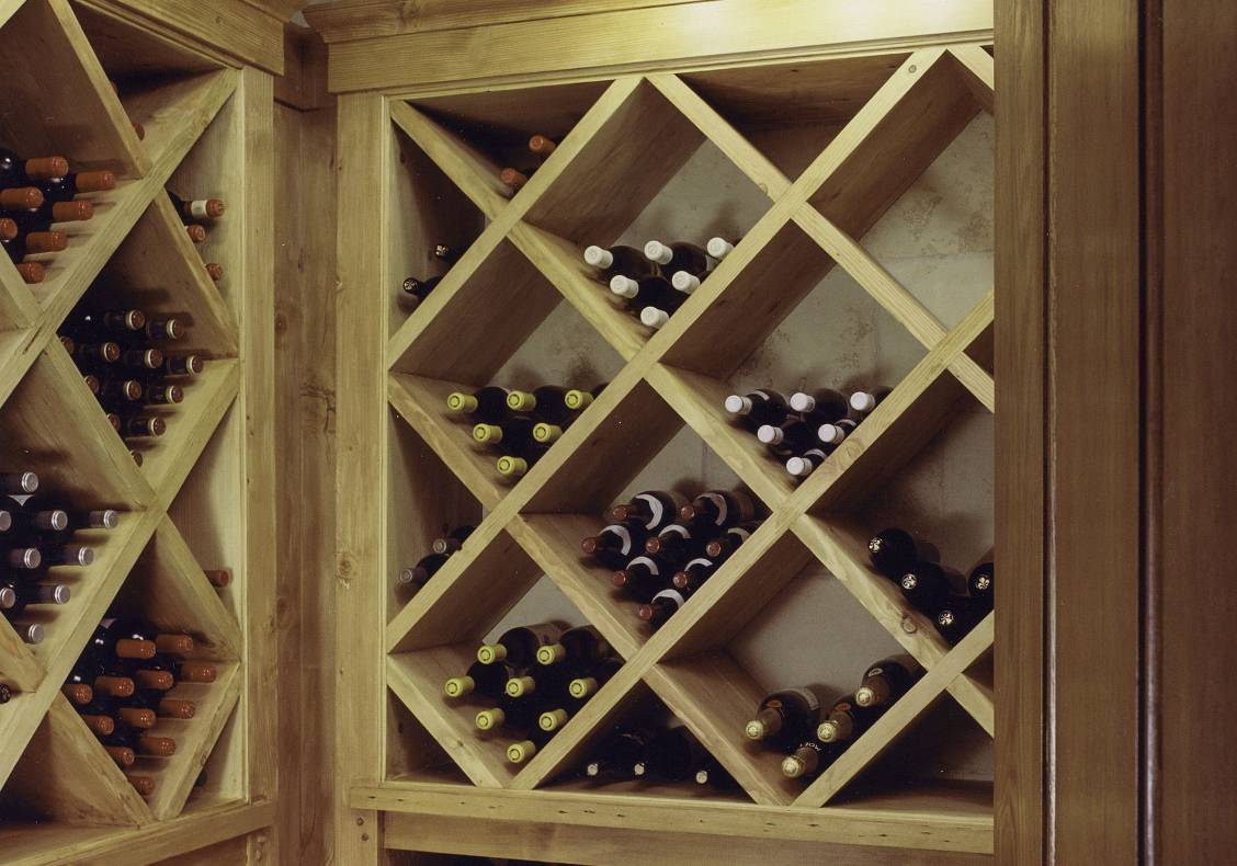 Wine is stored in a barrel-vaulted cellar.