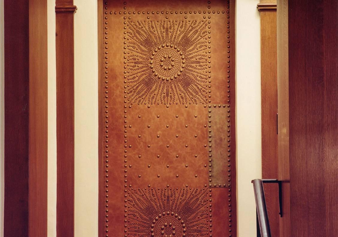 Studded door to the new media room.
