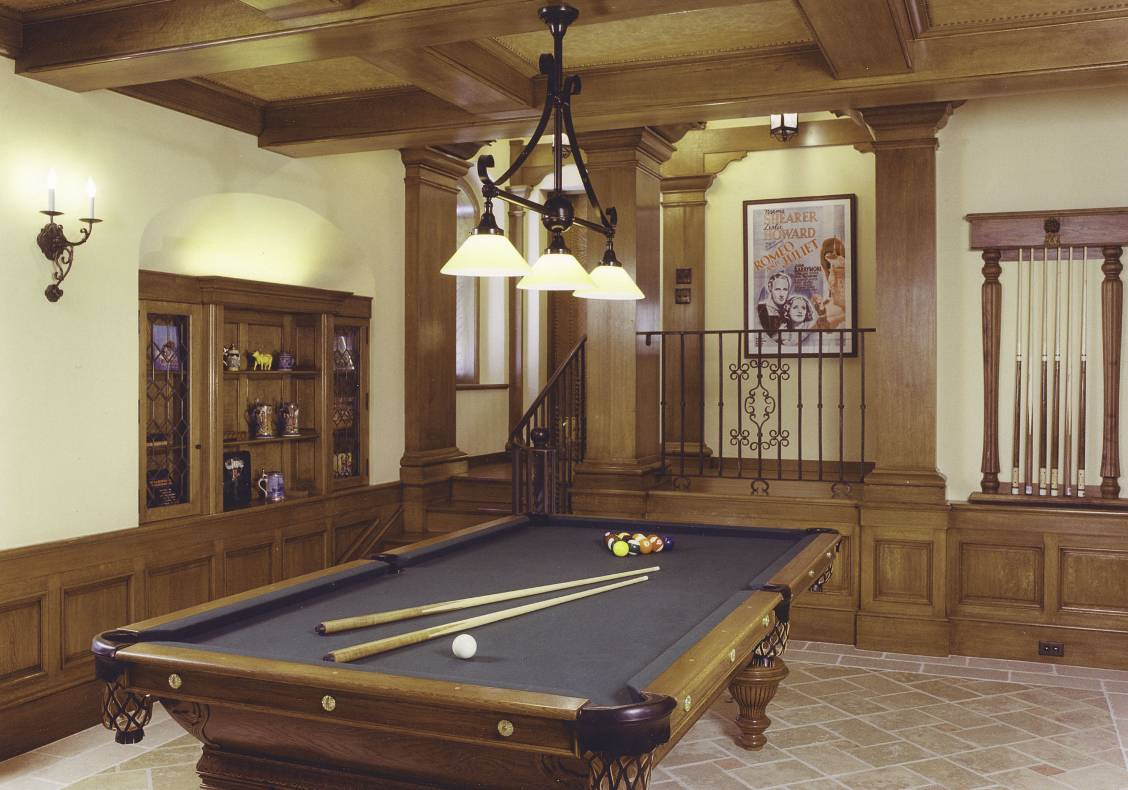 THe billiard room has a wood wainscot and leather ceiling