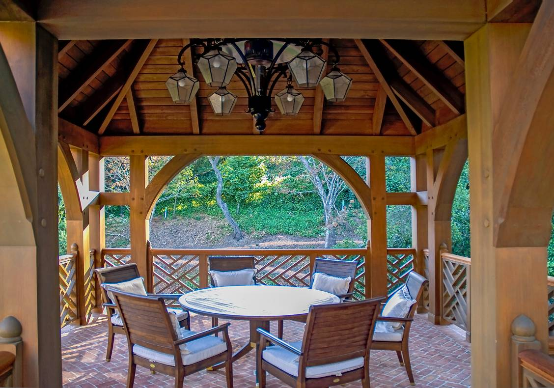 The tower gazebo has an outdoor loggia equipped with a gas radiant heating system integrated into a lantern chandelier.